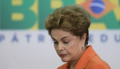 Brazil's President Dilma Rousseff arrives for a ceremony in Planalto presidential palace to launch an agricultural plan that allocates billions of dollars to farmers in Braslia, Brazil, Wednesday, May 4, 2016. Brazilís attorney general has asked the countryís highest court to authorize an investigation into embattled Rousseff over obstruction of justice allegations, according to major Brazilian news organizations. (AP Photo/Eraldo Peres)