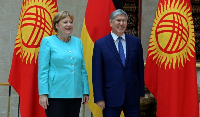 German Chancellor Angela Merkel (L) and Kyrgyz President Almazbek Atambayev pose during their meeting in Bishkek, Kyrgyzstan, July 14, 2016.  Sultan Dosaliev/Kyrgyz Presidental Press Service/Handout via Reuters ATTENTION EDITORS - THIS IMAGE WAS PROVIDED BY A THIRD PARTY.    FOR EDITORIAL USE ONLY. NO RESALES. NO ARCHIVES.