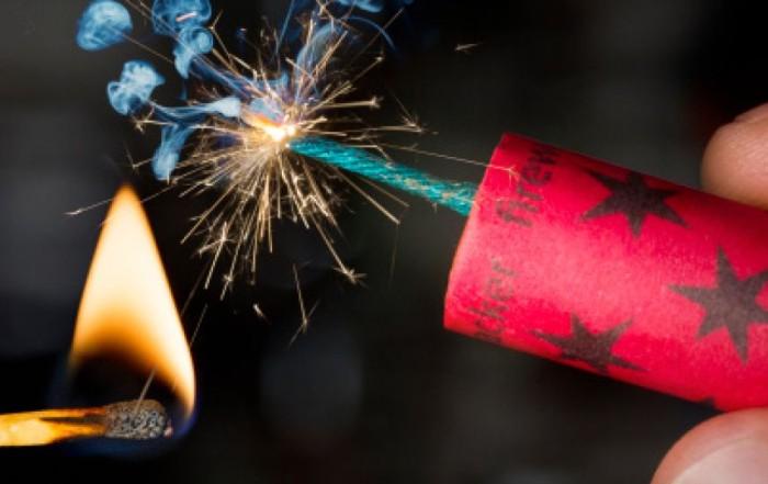 485972597-fireworks-cracker-being-lit-fuze-burning-gettyimages